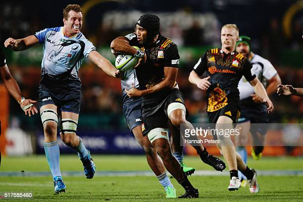 Taleni Seu of the Chiefs makes a break during the round five Super Rugby match between the Chiefs and the Western Force at FMG Stadium on March 26...