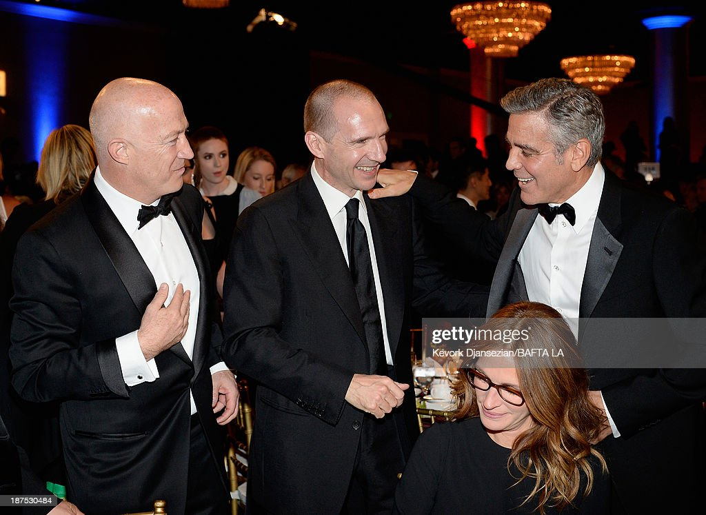 Talent Agent Bryan Lourd, actors Ralph Fiennes, Julia Roberts, and George Clooney attend the 2013 BAFTA LA Jaguar Britannia Awards presented by BBC America at The Beverly Hilton Hotel on November 9, 2013 in Beverly Hills, California.