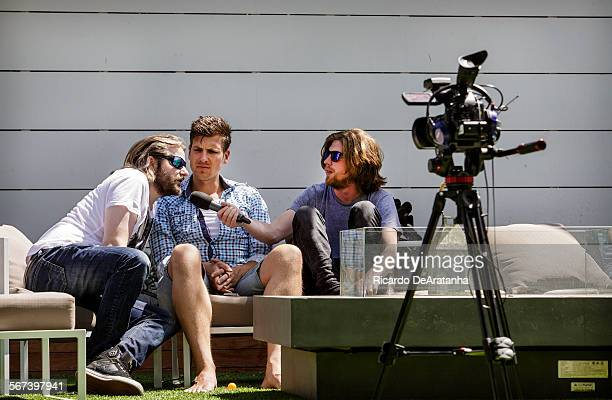 HOLLYWOOD CA JUNE 20 2014 Talent Erik Range aka Gronkh Lt David Hain Ct and Valentin Rahmel aka Sarazar recording a video segment in the backyard at...