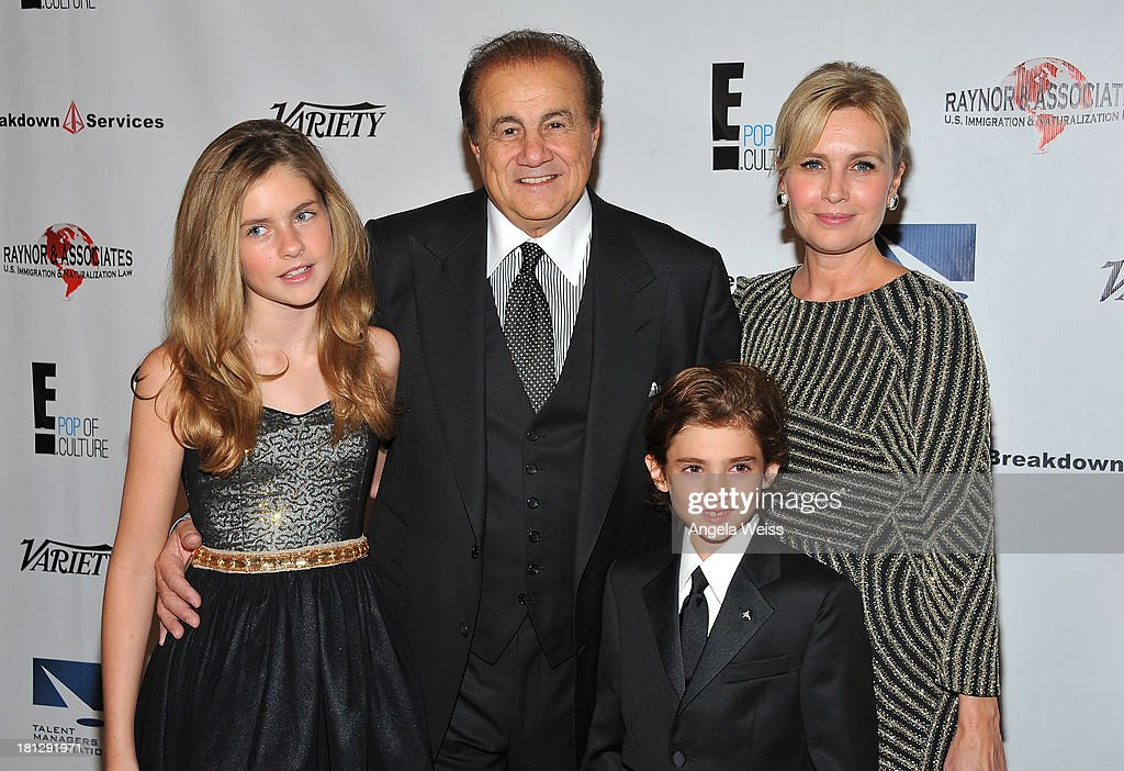 Talent manager Larry Thompson and his family attend the 12th Annual Heller Awards at The Beverly Hilton Hotel on September 19, 2013 in Beverly Hills, California.