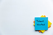 Talent Wanted, Business Concept. Sticky notes and words TALENT WANTED
