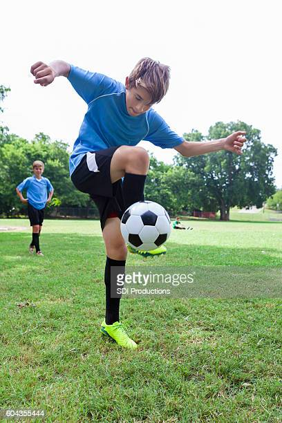 Talented soccer player performs tricks with the ball