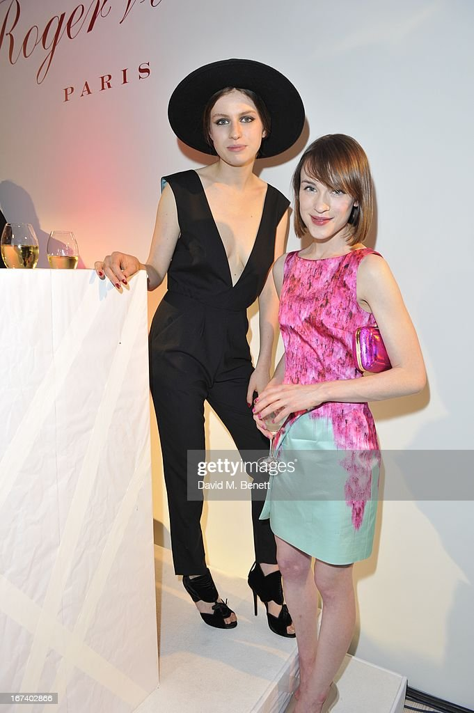 Tali Lennox (left) and guest at the Roger Vivier Book published by Rizzoli UK launch party at Saatchi Gallery on April 24, 2013 in London, England.