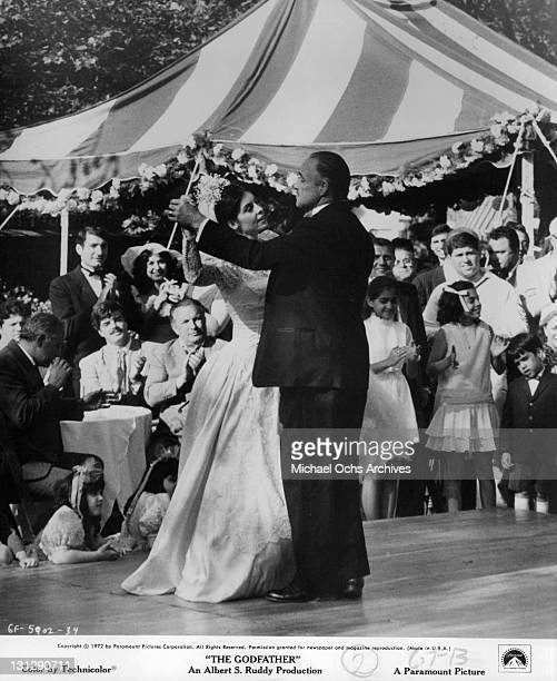 Talia Shire dancing with Marlon Brando at her wedding in a scene from the film 'The Godfather' 1972
