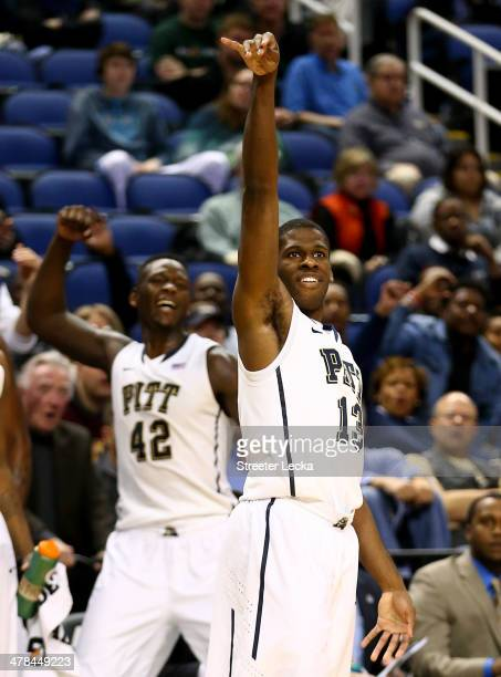 Talib Zanna and Lamar Patterson of the Pittsburgh Panthers celebrate after a basket against the Wake Forest Demon Deacons during the second round of...