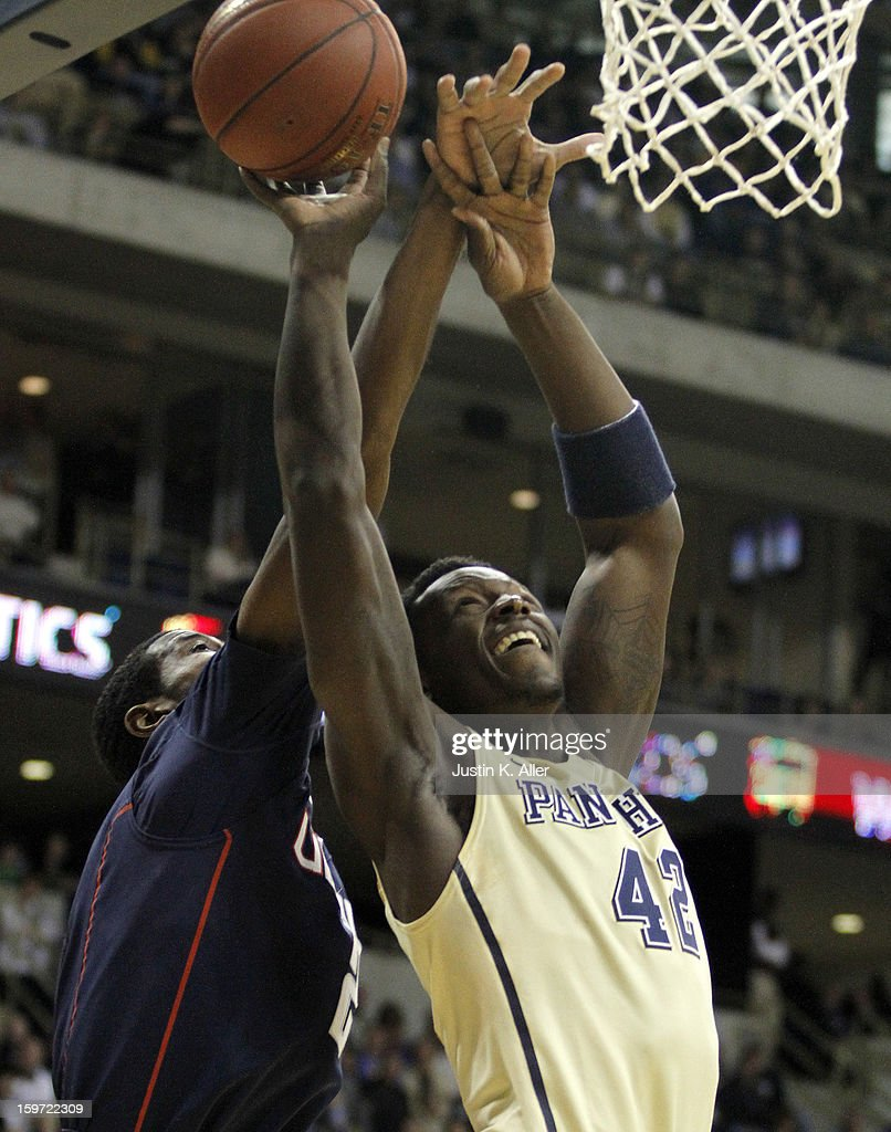 Talib Zanna #42 of the Pittsburgh Panthers attempts a layup against the Connecticut Huskies at Petersen Events Center on January 19, 2013 in Pittsburgh, Pennsylvania.