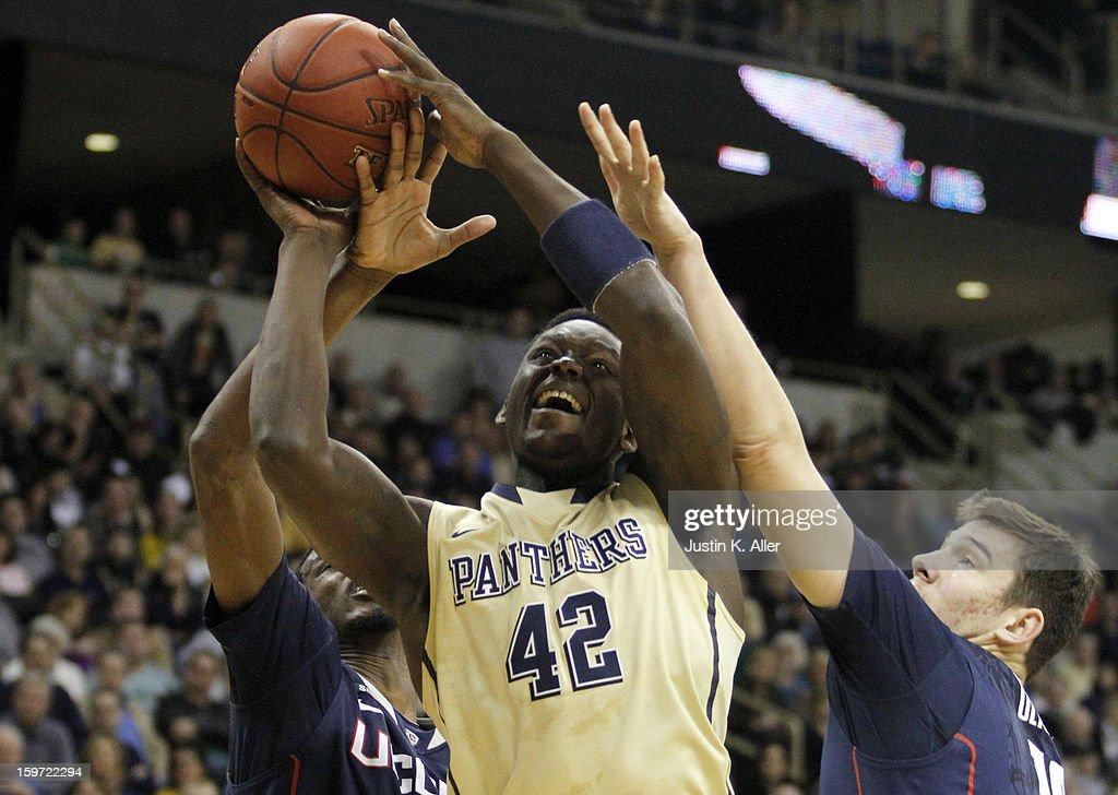 Talib Zanna #42 of the Pittsburgh Panthers battles for a rebound against the Connecticut Huskies at Petersen Events Center on January 19, 2013 in Pittsburgh, Pennsylvania.