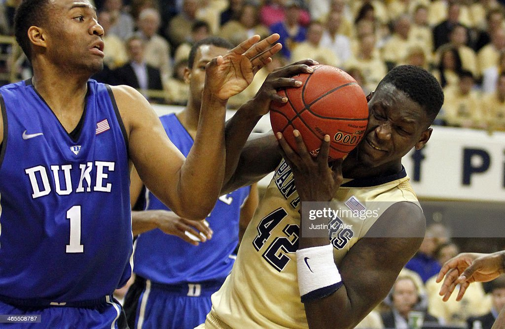 Talib Zanna #42 of the Pittsburgh Panthers battles for a rebound against the Duke Blue Devils at Petersen Events Center on January 27, 2014 in Pittsburgh, Pennsylvania.