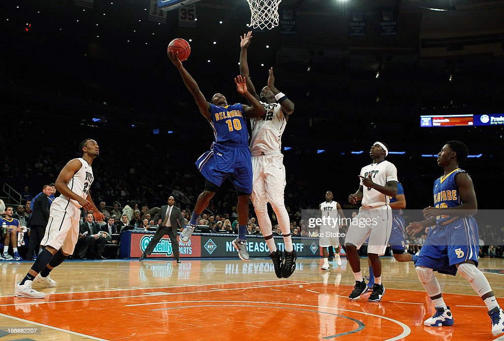 Talib Zanna #42 of the Pittsburgh Panthers defends the net against Devon Saddler #10 of the Delaware Fightin' Blue Hens at Madison Square Garden on November 23, 2012 in New York City. Pittsburgh Panthers defeated the Delaware Fightin' Blue Hens 85-59.