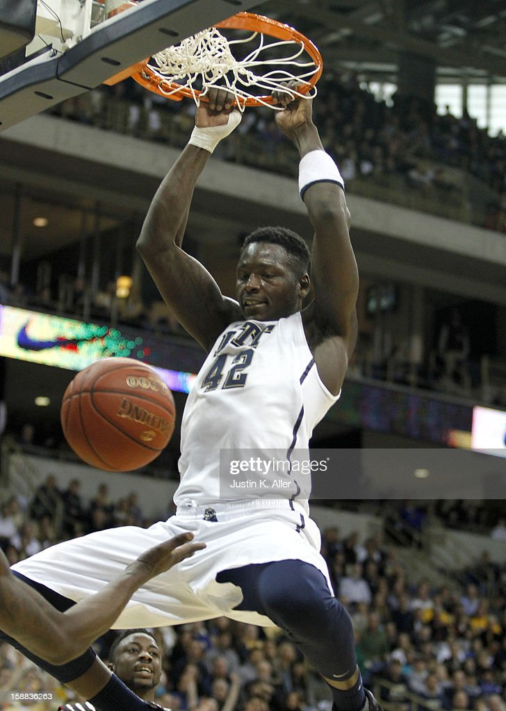Talib Zanna #42 of the Pittsburgh Panthers dunks the ball in the first half against the Cincinnati Bearcats during the game at Petersen Events Center on December 31, 2012 in Pittsburgh, Pennsylvania.