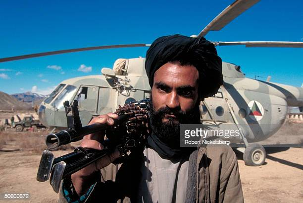 Taliban fighter by Russian Mi8 helicopter captured by radical Islamic clericled civil war faction in taking HQ of rival mujahedin army led by...