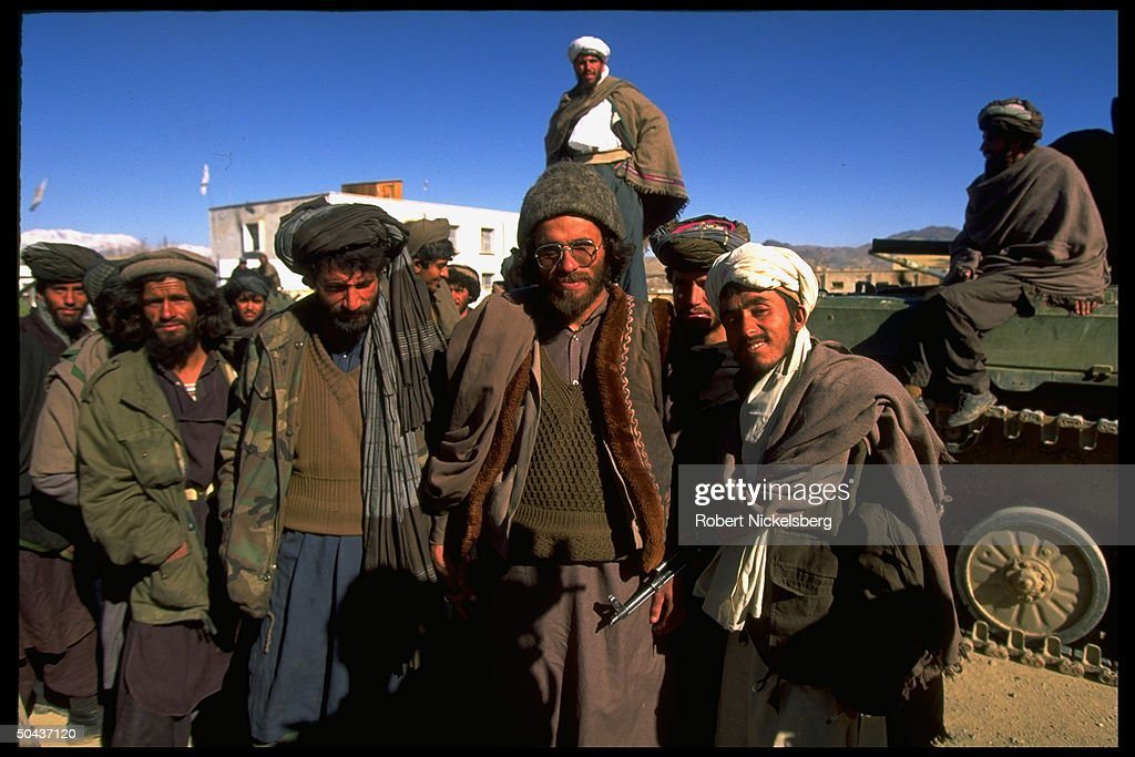 Taliban fighters at HQ taken fr. opposition Hekmatyar mujahedin by radical Islamic cleric-led faction on top in civil war, nr. govt-held Kabul.
