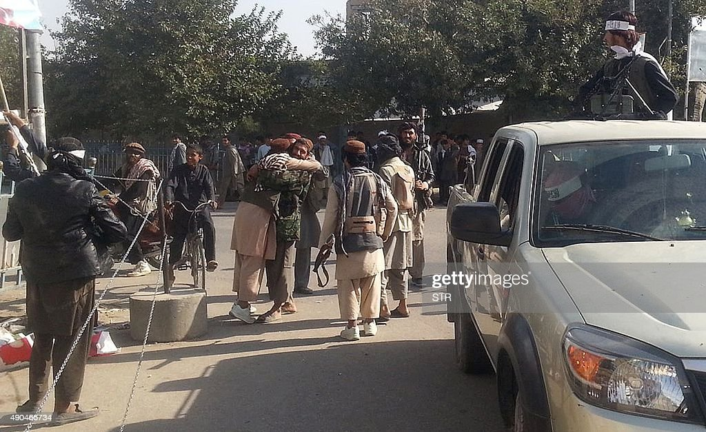 Taliban fighters hug each other a day after they overran the strategic northern city of Kunduz on September 29 2015 Afghanistan on September 29...