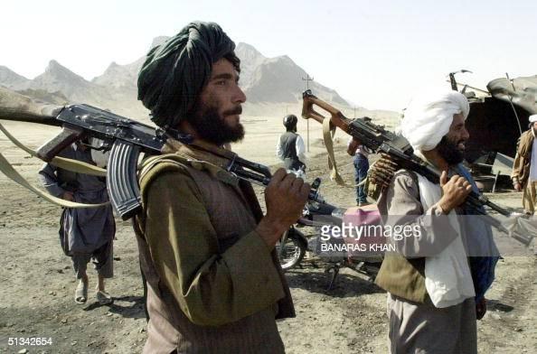 Taliban gumen control KandaharHerat Highway near Kandahar city 31 October 2001 where two oil tankers were hit by American missiles killing three...
