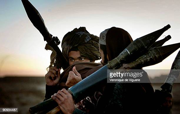 Taliban insurgents serving under Mollah Najib's command in Andar district Ghazni province discuss strategy for an operation against the coalition...