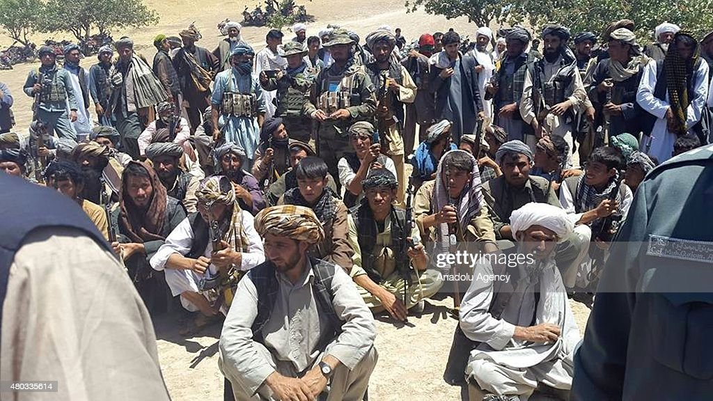 Taliban militants hold their weapons before surrendering them to Afghan authorities in western Badghis province of Afghanistan on July 11 2015 One...