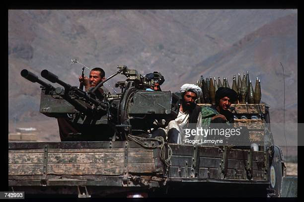 Taliban militiamen ride in a heavily armed vehicle October 10 1996 in Kabul Afghanistan The Taliban army faces opposition by the guerrillas of Ahmas...