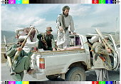 Taliban Muslim militia fighters scramble aboard their Toyota pickup carrying RPG7 antitank rocket launchers and assault rifles 16 November The...