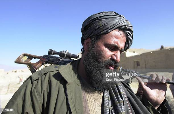 Taliban sniper Mohamed Said Kouchai surrenders of at the village Maidan Shar 30 miles south of Kabul after a weeklong violent standoff with Northern...