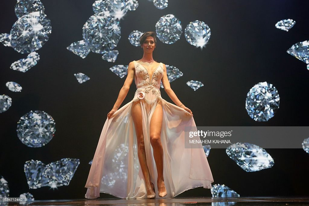 Talin abu Hana, 21, a Christian Arab-Israeli from Northern Israel, performs on stage during Israel's first Miss Trans beauty pageant at Habima national theater in Tel Aviv on May 27, 2016, which marks the beginning of the 2016 Pride events. / AFP / MENAHEM