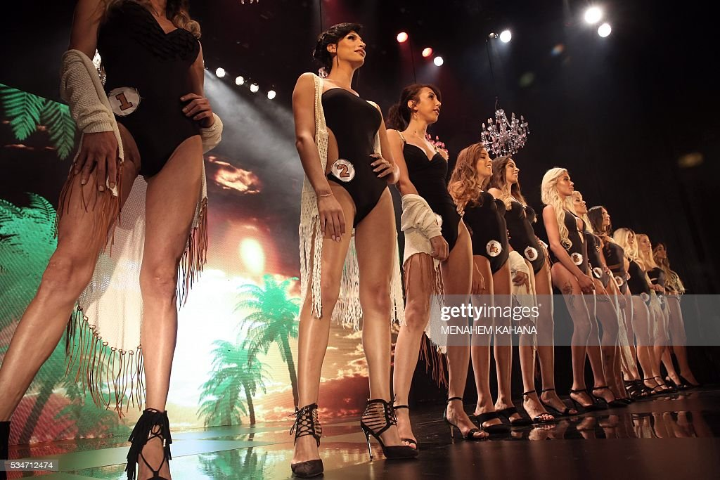Talin abu Hana (2nd-L), 21, a Christian Arab-Israeli from Northern Israel, performs on stage during Israel's first Miss Trans beauty pageant at Habima national theater in Tel Aviv on May 27, 2016, which marks the beginning of the 2016 Pride events. / AFP / MENAHEM
