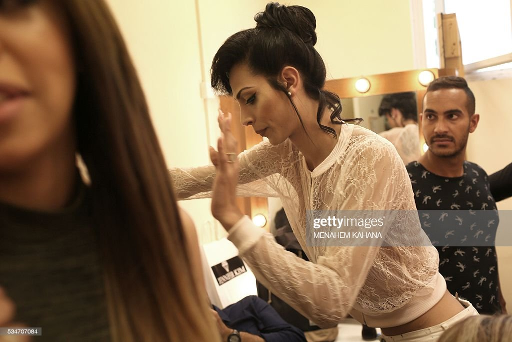 Talin abu Chana, 21, a Christian Arab-Israeli from Northern Israel, prepares for Israel's first Miss Trans beauty pageant at Habima national theater in Tel Aviv on May 27, 2016, which marks the beginning of the 2016 Pride events. / AFP / MENAHEM