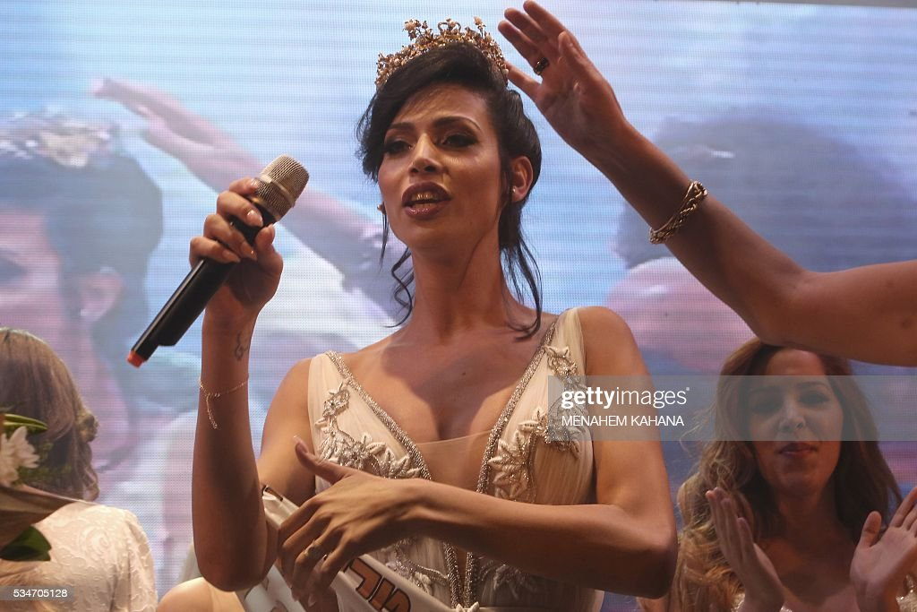 Talin abu Chana, 21, a Christian Arab-Israeli from Northern Israel, reacts upon winning Israel's first Miss Trans beauty pageant at Habima national theater in Tel Aviv on May 27, 2016, which marks the beginning of the 2016 Pride events. / AFP / MENAHEM