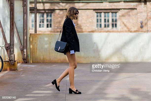 Talisa Sutton wearing a blue white striped button shirt a black blazer Gucci loafers and leather shorts outside C Meo Collective at MercedesBenz...