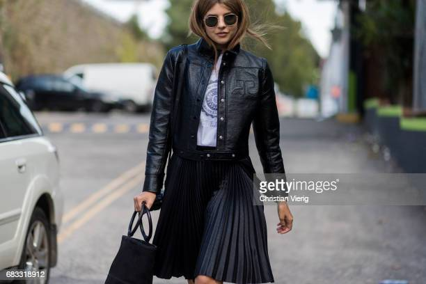 Talisa Sutton wearing a leather jacket skirt heels sheer socks at day 2 during MercedesBenz Fashion Week Resort 18 Collections at Carriageworks on...