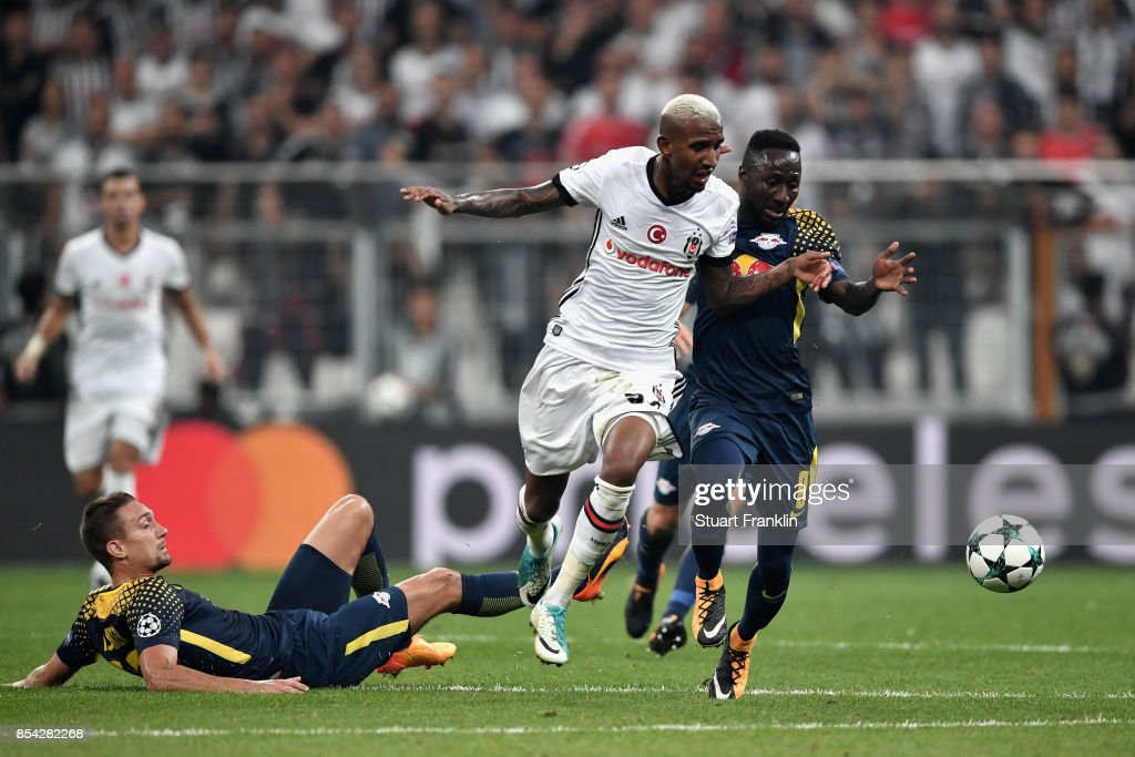Talisca of Besiktas and Jean-Kevin Augustin of RB Leipzig battle for possession during the UEFA Champions League Group G match between Besiktas and RB Leipzig at Besiktas Park on September 26, 2017 in Istanbul, Turkey.