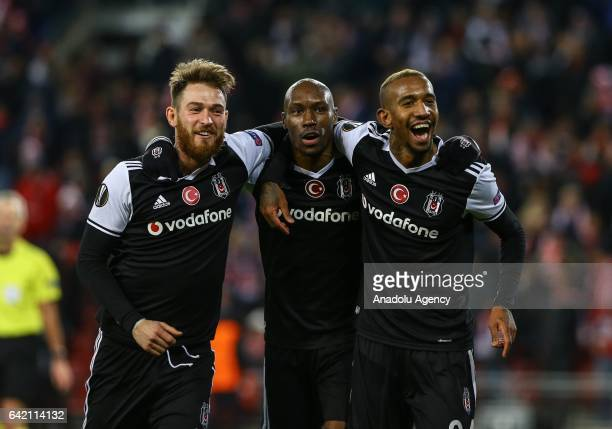 Talisca of Besiktas celebrates scoring a goal with Atiba Hutchhinson and Omer Sismanoglu during the UEFA Europa League Round of 32 match between...