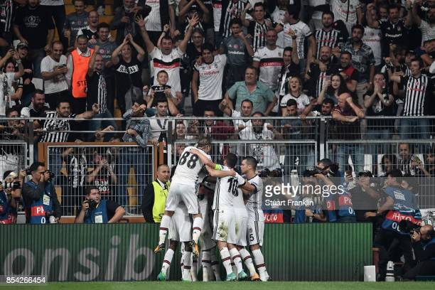 Talisca of Besiktas celebrates scoring his sides second goal with his Besiktas team mates during the UEFA Champions League Group G match between...