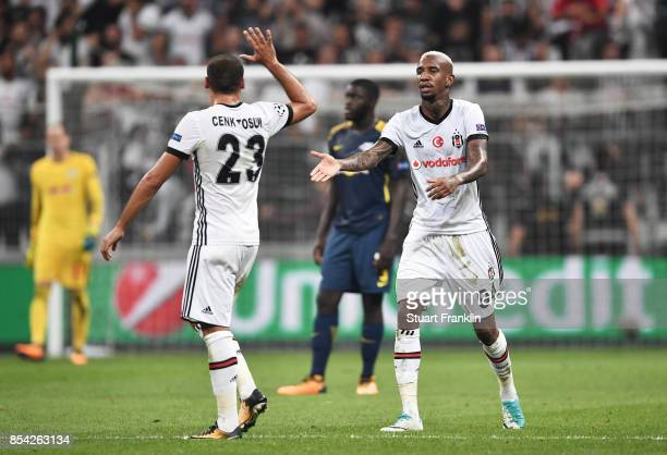 Talisca of Besiktas celebrates scoring his sides second goal with Cenk Tosun of Besiktas during the UEFA Champions League Group G match between...