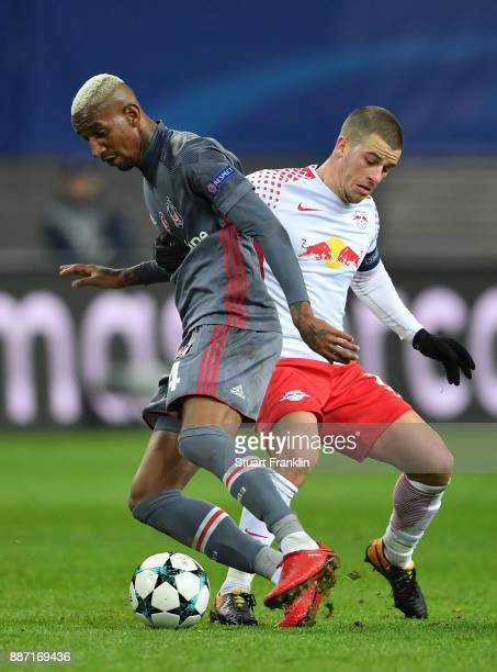 Talisca of Besiktas is challenged by Diego Demme of RB Leipzig during the UEFA Champions League group G match between RB Leipzig and Besiktas at Red...