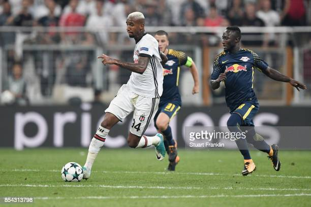 Talisca of Besiktas takes the ball past Naby Keita of RB Leipzig during the UEFA Champions League Group G match between Besiktas and RB Leipzig at...