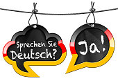 Two speech bubbles with German flag and text Sprechen Sie Deutsch? Ja! (Do you speak German? Yes!). Isolated on white