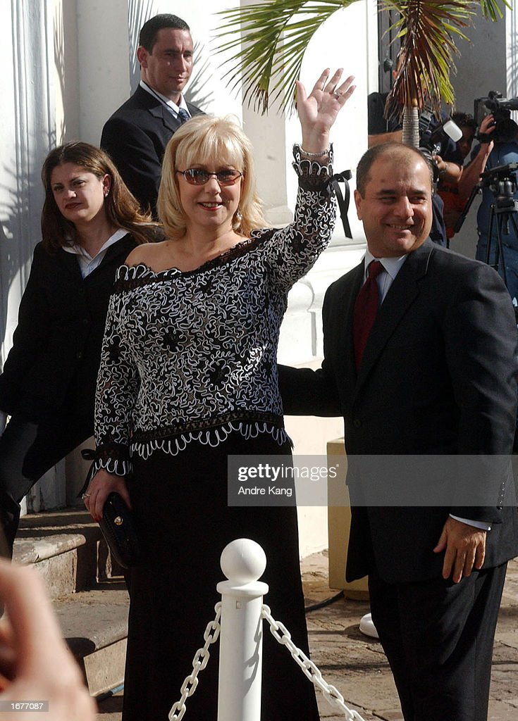 Talk show host Cristina Saralegui waves as she arrives at the Old San Juan Cathedral for singer Marc Anthony and wife Dayanara Torres' Catholic wedding December 7, 2002 in San Juan, Puerto Rico.