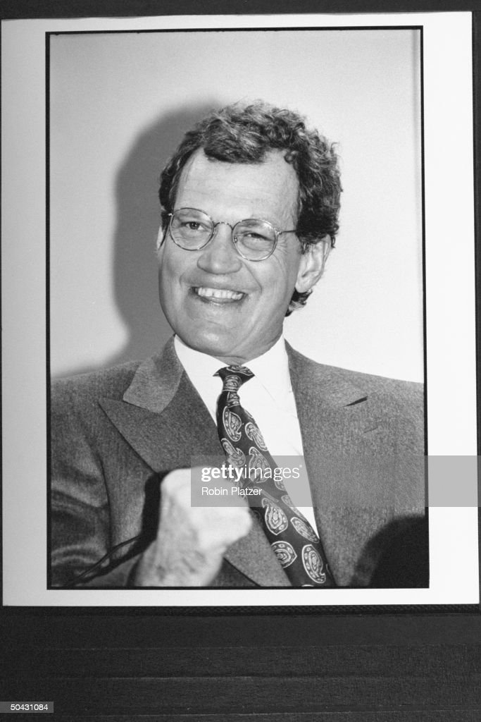 Talk show host <a gi-track='captionPersonalityLinkClicked' href=/galleries/search?phrase=David+Letterman+-+Televisiepresentator&family=editorial&specificpeople=171322 ng-click='$event.stopPropagation()'>David Letterman</a> grinning zanily & proferring clenched fist, while announcing his move fr. NBC to CBS, at press conf.; his show will air against NBC's The Tonight Show w. Jay Leno.