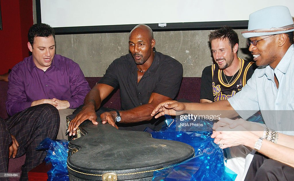 Talk show host Jimmy Kimmell, basketball player Karl Malone, actors David Arquette and <a gi-track='captionPersonalityLinkClicked' href=/galleries/search?phrase=Jamie+Foxx&family=editorial&specificpeople=201715 ng-click='$event.stopPropagation()'>Jamie Foxx</a> have a laugh as Karl Malone receives a gift at a party held for Gary Payton and Karl Malone celebrating both Los Angeles Lakers players' birthdays at the Lucky Strike on July 24, 2003 in Los Angeles, California.