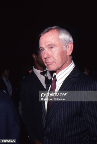 Talk show host Johnny Carson attends an event with dessert in 1977 in Los Angeles California