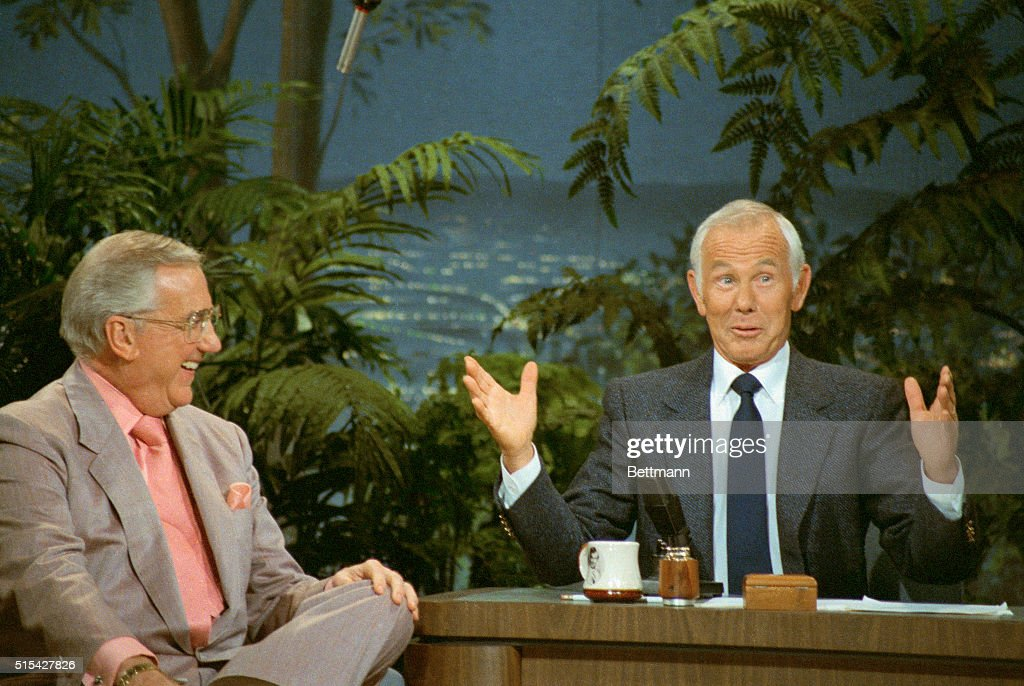 Talk show host Johnny Carson gestures while talking to co-host <a gi-track='captionPersonalityLinkClicked' href=/galleries/search?phrase=Ed+McMahon&family=editorial&specificpeople=216392 ng-click='$event.stopPropagation()'>Ed McMahon</a> on The Tonight Show.