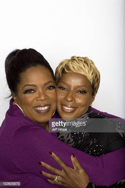 Talk show host Oprah Winfrey and singer Mary J Blige pose at the Toronto Film Festival 2009