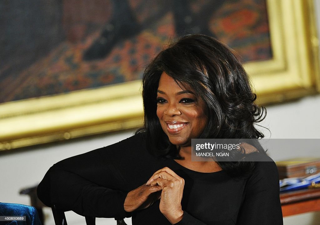TV talk show host Oprah Winfrey attends the Presidential Medal of Freedom ceremony at the White House on November 20, 2013 in Washington, DC. The Medal of Freedom is the country's highest civilian honor. AFP PHOTO/Mandel NGAN