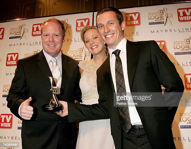 TV talk show host Rove McManus poses with his Rove Live costars Peter Helliar and Carrie Bickmore with their TV Week Silver Logie award for Most...