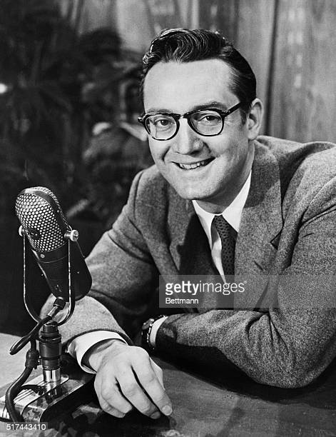 Talk show host Steve Allen sits at a microphone