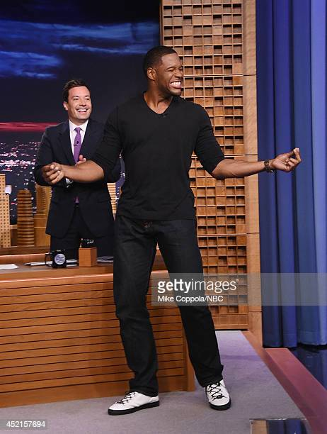Talk show host/comedian Jimmy Fallon welcomes former professional football player and talk show host Michael Strahan during his visit to 'The Tonight...