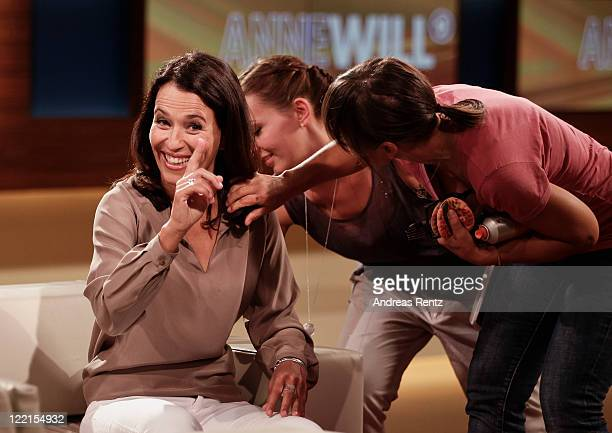 TV talk show hostess Anne Will gestures while she receives makeup during the photocall for the political talkshow 'Anne Will' on August 26 2011 in...