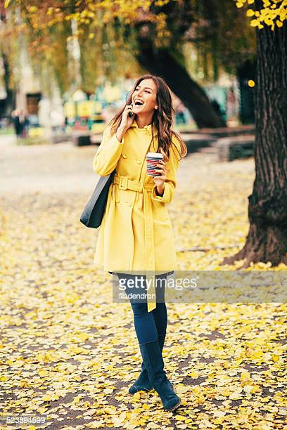 Talking on the phone in the autumn