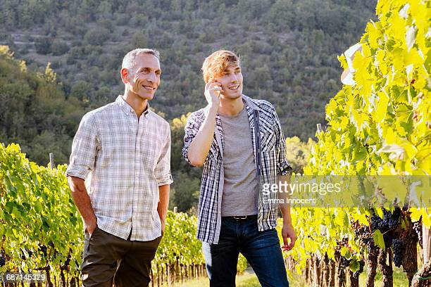 Talking on the phone in the vineyard