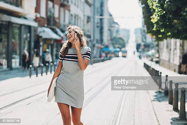 Talking on the phone on the street